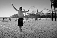 Man on tightrope Santa Monica California